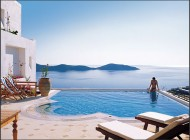 """""""There is no place like Santorini, in the whole world"""" say our readers, who love the """"whitewashed buildings, wonderful beaches and views to die for."""" Their best memories are of the caldera vistas, the black-sand beach and the """"crystal clear water,"""" but they also cast their votes for the island's great shopping"""" and """"awesome food."""" One reader said to """"stroll the streets, walk the stairs down to the sea level and just revel in the beauty and friendliness of the people on this charming island."""" Another added, """"It's also a great place for first-time divers due to the calm seas."""""""